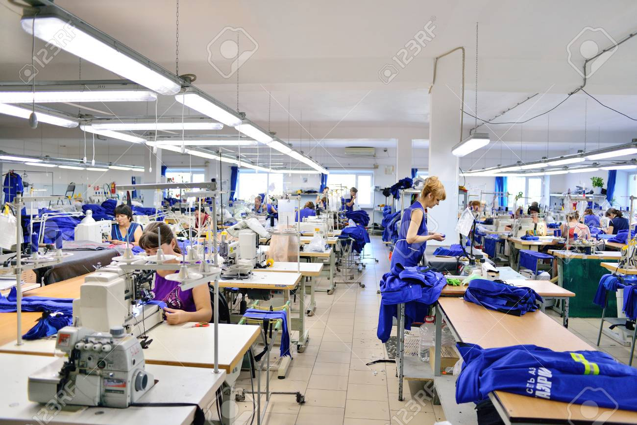 GUKOVO, RUSSIA - SEPTEMBER, 2016: Workers Work In A Garment Factory Stock Photo, Picture And Royalty Free Image. Image 70892198.